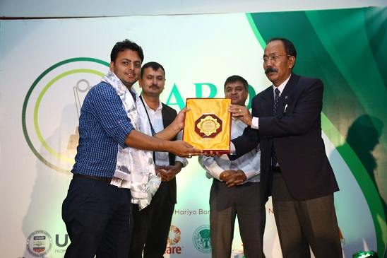 Ramesh Bhushal being honored for his contribution in environment beat