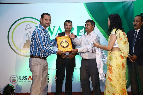 Saroj Koirala being honored for his contribution in environment beat.
