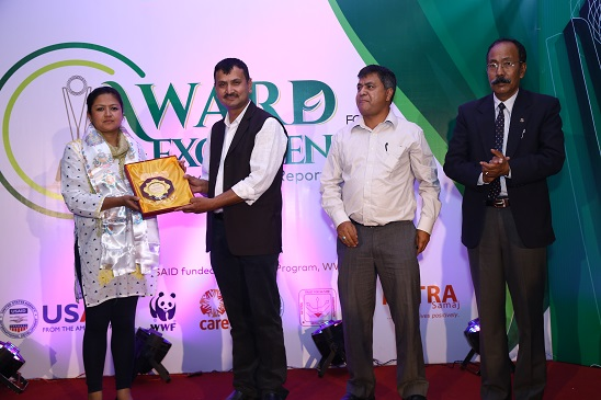 Shobha Manandhar, being honored for her contribution in environment beat.