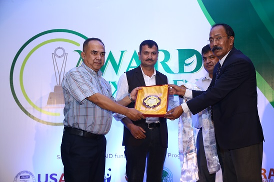 Raju Silwal being honored for his contribution in environment beat.