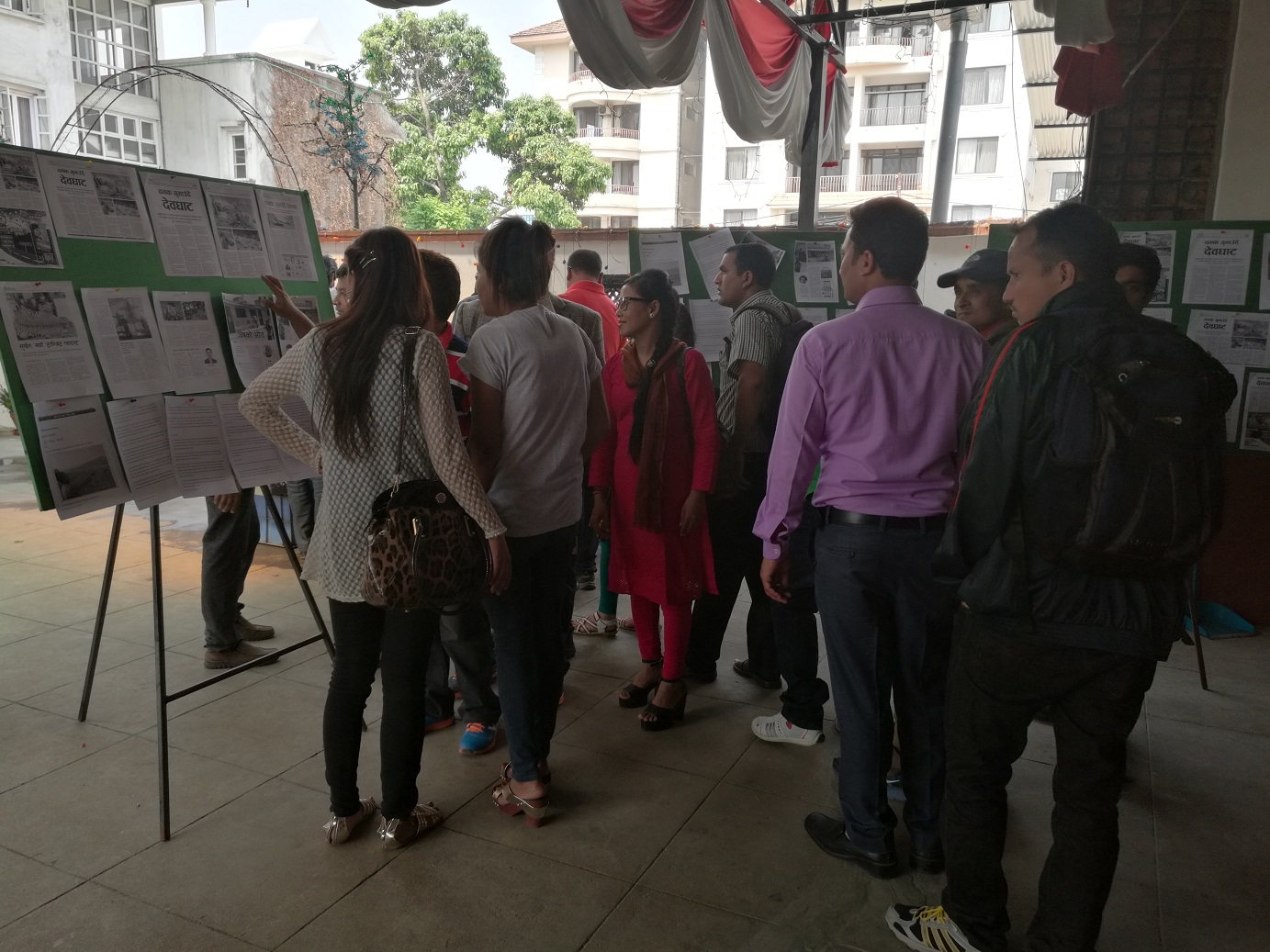 Participants reading news, articles or stories displayed at the premises of the venue. The gallery walk was set up to display the articles, stories and reports received for the environment reporting competition.